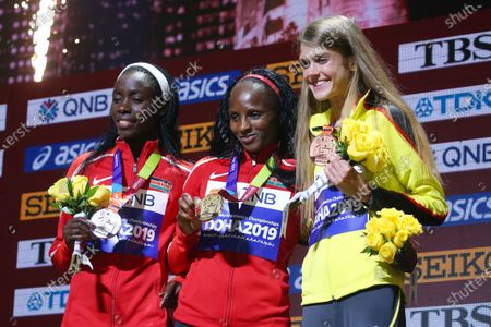 Stock Photo of (L to R)  Margaret Chelimo Kipkemboi,  Hellen Obiri (KEN),  Konstanze Klosterhalfen (GER) - Athletics :  IAAF World Championships Doha 2019  Women's 5000m Medal Ceremony  at Khalifa International Stadium in Doha, Qatar.
