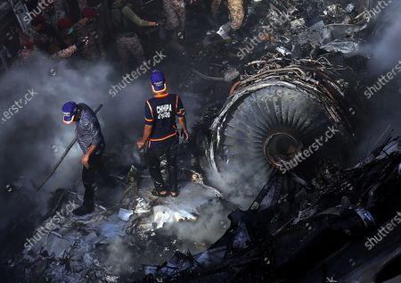 YEARENDER 2020  DISASTERS AND ACCIDENTS  Rescue workers search for the bodies and survivors amid wreckage of a passenger plane of state run Pakistan International Airlines, after it crashed in a residential area, in Karachi, Pakistan, 22 May 2020. A Pakistan International Airlines passenger flight, with over 100 people on board, crashed on 22 May as it was about to land near a residential area close to the airport in the port city of Karachi, a civil aviation official said.