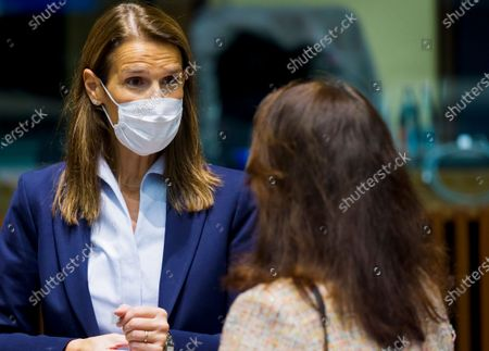Belgium's Foreign Minister Sophie Wilmes, left, speaks with Sweden's Foreign Minister Ann Linde during a meeting of European Union foreign ministers in Luxembourg. Former Belgian Prime minister Sophie Wilmes has been hospitalized in intensive care after getting infected with the coronavirus. The 45-year-old Wilmes, who was admitted to hospital on Wednesday evening Oct. 21, said last week she thought she got infected within her family circle