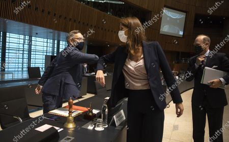 Stock Image of Minister of State for Europe at the German Federal Foreign Office Michael Roth, left, greets Belgian Foreign Minister Sophie Wilmes with an elbow bump during a meeting of EU General Affairs ministers in Luxembourg. Former Belgian Prime minister Sophie Wilmes has been hospitalized in intensive care after getting infected with the coronavirus. The 45-year-old Wilmes, who was admitted to hospital on Wednesday evening, said last week she thought she got infected within her family circle