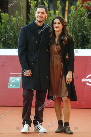 Gabriele Mainetti (L) and partner Alice Vicario pose on the red carpet at the 15th annual Rome International Film Festival, in Rome, Italy, 22 October 2020. The film festival runs from 15 to 25 October.