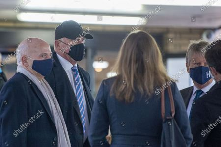 (2nd L) Former tennis professional Boris Becker (52), wearing a facemask arrives at Southwark Crown Court for a Plea and Trial Preparation where he faces charges of failure to comply with a legal obligation to disclose financial information when filing for bankruptcy in 2017 including a number of properties and bank accounts.
