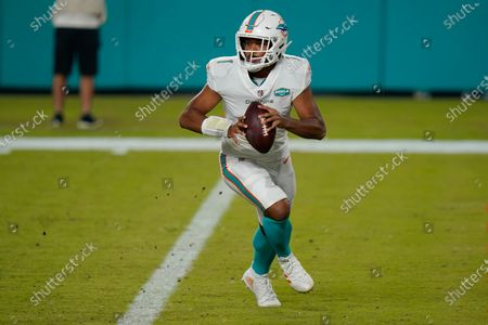 Miami Dolphins quarterback Tua Tagovailoa (1) looks to pass the ball during the second half of an NFL football game against the New York Jets, in Miami Gardens, Fla. Hopes are high Tagovailoa will be the best of the 22 quarterbacks to start for Miami since Dan Marino retired following the 1999 season