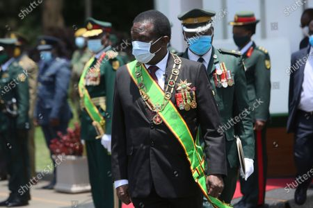 Zimbabwean President Emmerson Mnangagwa prepares to inspect a guard of honour at State House in Harare, . Mnangagwa officially opened the third session of the ninth parliament. where he urged Zimbabweans not to be complacent due to the low positive cases of COVID-19 currently been recorded across the country