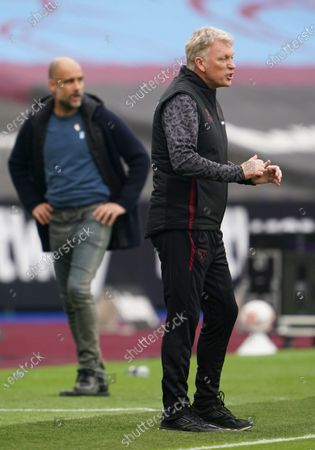 West Ham manager David Moyes in front of Manchester City Manager Pep Guardiola