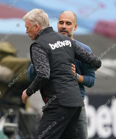West Ham manager David Moyes and Manchester City Manager Pep Guardiola at full time
