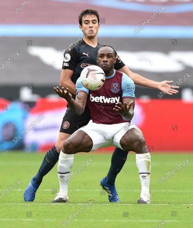 Michail Antonio of West Ham battles with Ruben Dias of Manchester City