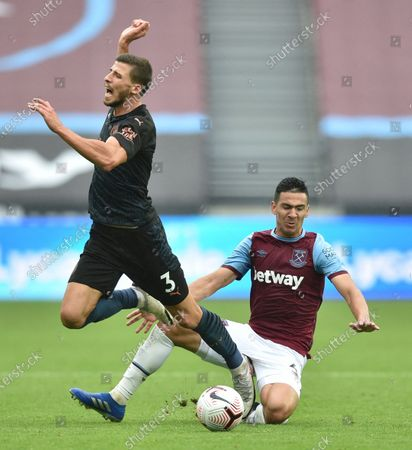 Stock Image of Fabián Balbuena is penalised for this tackle on Ruben Dias of Manchester City