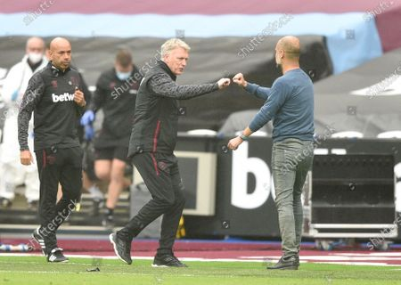 Stock Image of West Ham manager David Moyes and Manchester City Manager Pep Guardiola at full time