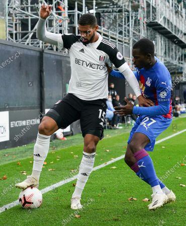 Ruben Loftus-Cheek of Fulham holds off Tyrick Mitchell of Crystal Palace