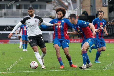 Ruben Loftus-Cheek of Fulham (15) under pressure from Jairo Riedewald of Crystal Palace (44) and Scott Dann of Crystal Palace (6)