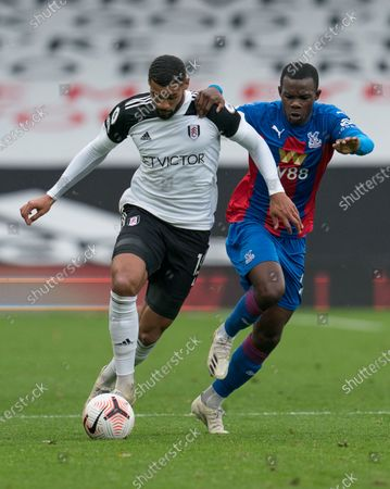 Ruben Loftus-Cheek of Fulham (15) and Tyrick Mitchell of Crystal Palace (27)