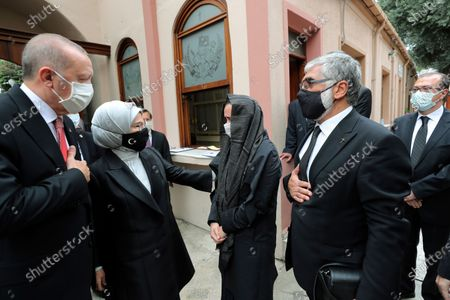 Stock Picture of Turkey's President Recep Tayyip Erdogan, left, and his wife Emine Erdogan speak with the family members of Markar Esayan, a Turkish lawmaker from Erdogan's ruling Justice and Development Party, who died of cancer at 51, during a funeral ceremony at the Armenian Patriarchate Church, in Istanbul