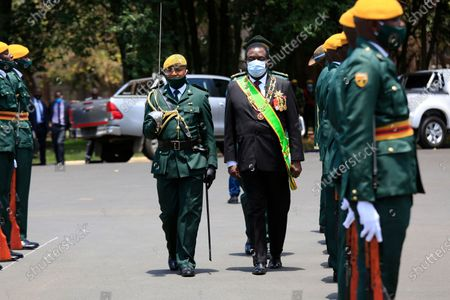Zimbabwean President Emmerson Mnangagwa (C) inspects a guard of honour  before delivering the State of the Nation address and officially opened the third session of the Ninth Parliament virtually, at the State House in Harare, Zimbabwe, 22 October 2020.