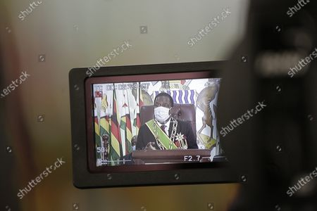 A screen shows Zimbabwe President Emmerson Mnangagwa as he delivers the State of the Nation address and officially opened the third session of the Ninth Parliament virtually, at the State House in Harare, Zimbabwe, 22 October 2020.