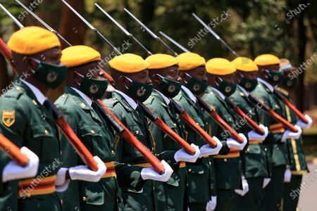 Members of the Presidential Guard arrive for the delivery of the State of the Nation address and official opening the third session of the Ninth Parliament virtually, at the State House in Harare, Zimbabwe, 22 October 2020.