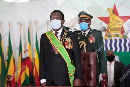 Stock Photo of Zimbabwean President Emmerson Mnangagwa (L) arrives for the delivery of  the State of the Nation address and to officially open the third session of the Ninth Parliament virtually, at the State House in Harare, Zimbabwe, 22 October 2020.