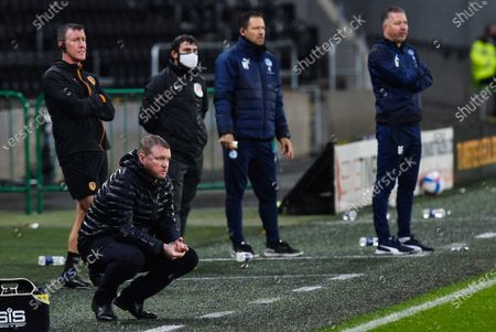 Manager Grant McCann of Hull City with opposite number Manager Darren Ferguson of Peterborough United