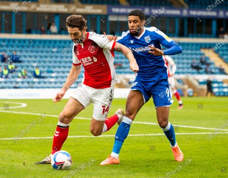 Charlie Mulgrew of Fleetwood Town and Dominic Samuel of Gillingham