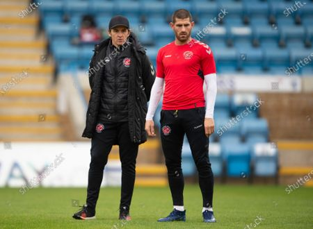 Joey Barton manager of Fleetwood Town with Ched Evans of Fleetwood Town