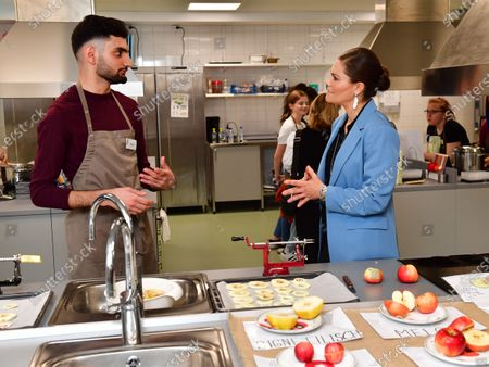Crown Princess Victoria visits the Rinman special school in Eskilstuna, Sodermanland county. The Crown Princess has a chat with student Didar during the home economics class where the todays theme was apples.