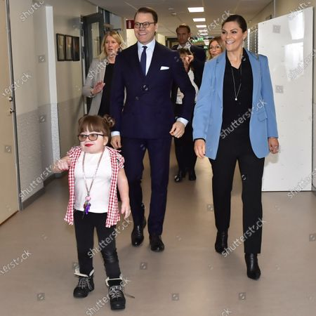 Student Elin Eriksson guide Crown Princess Victoria and Prince Daniel during their visit to Rinman special school in Eskilstuna, Sodermanland county.