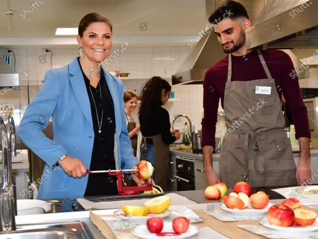 Crown Princess Victoria visits the Rinman special school in Eskilstuna, Sodermanland county. The Crown Princess helps student Didar during the home economics class where the todays theme was apples.