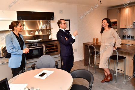 Crown Princess Victoria and Prince Daniel talk to Rania Matar CEO and founder of kitchen design company Familjekök design AB during their day visit to Sodermanland county.
