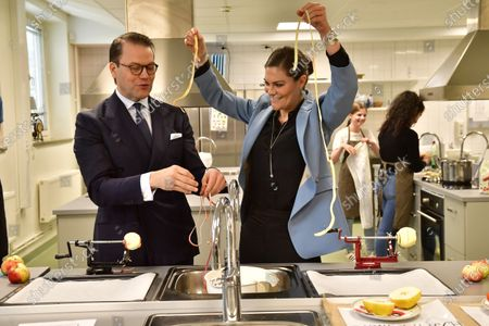 Crown Princess Victoria and Prince Daniel visit the Rinman special school in Eskilstuna, Sodermanland county. Here they help during the home economics class with the todays theme, apples.