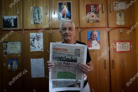 """Former Brazilian soccer player Antonio Schank Filho, 85, remembers his time as a player and the match in which soccer legend Pele scored his first goal, during an interview with Efe at his home in Sao Bernardo do Campo, near from Sao Paulo, Brazil, 21 October 2020 (issued 22 October). The first page of Pele's reign was written on 07 September 1956. That day, a holiday in Brazil, a 15-year-old boy made his debut with the Santos first team in a stadium that does not exist today and scored his first goal: """"Nobody  imagined he was going to be the best in the world"""" recalls one of his rivals. His debut was in a friendly against Corinthians de Santo Andre. Antonio Schank Filho, at the time steering wheel of that modest club in the metropolitan region of Sao Paulo, still remembers in detail the goalscoring baptism of Edson Arantes do Nascimento, who will turn 80 this Friday."""