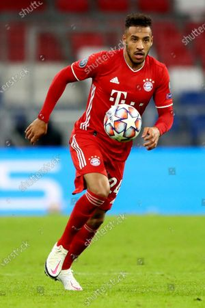 Bayern's Corentin Tolisso controls the ball during the Champions League Group A soccer match between Bayern Munich and Atletico Madrid at the Allianz Arena in Munich, Germany