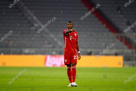 Stock Image of Bayern's David Alaba gestures during the Champions League Group A soccer match between Bayern Munich and Atletico Madrid at the Allianz Arena in Munich, Germany