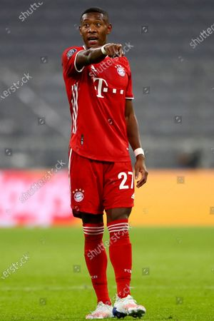 Bayern's David Alaba gestures during the Champions League Group A soccer match between Bayern Munich and Atletico Madrid at the Allianz Arena in Munich, Germany