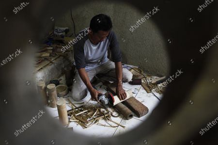 A craftsman works on drinking bottles (tumbler) Eco-Friendly from bamboo at the Bambukeun.id workshop, in Bogor City.
