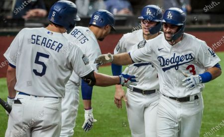 Arlington, Texas, Wednesday, October 21, 2020 Los Angeles Dodgers second baseman Chris Taylor (3) homers in the fifth inning in game two of the World Series at Globe Life Field. (Robert Gauthier/ Los Angeles Times)