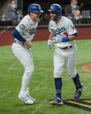 Arlington, Texas, Wednesday, October 21, 2020 Los Angeles Dodgers second baseman Chris Taylor (3) homers in the fifth inningand gets an earful from teammate Los Angeles Dodgers second baseman Enrique Hernandez (14) in game two of the World Series at Globe Life Field. (Robert Gauthier/ Los Angeles Times)