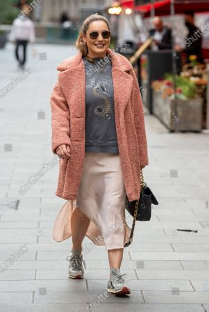 Stock Image of Kelly Brook seen arriving at the Global Radio Studios for her Heart radio show.