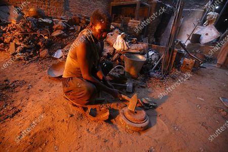 A Pakistani laborer works at a factory that produces Iron hammer in Karachi, Pakistan, 22 October 2020. Pakistani Prime Minister Imran Khan on 20 October, ordered strict action against hoarders and profiteers to control the rising inflation that has affected the poor masses at large.