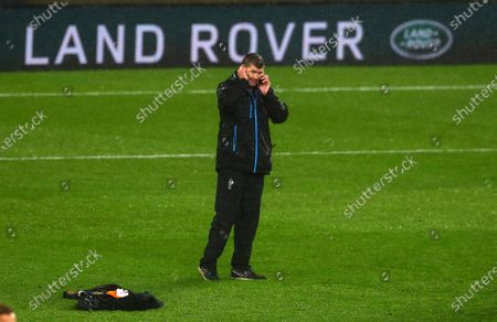 Exeter Chiefs Director of Rugby Rob Baxter on the phone as his side celebrate their victory