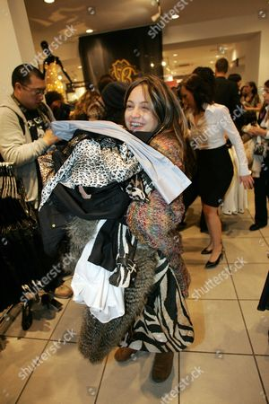 Andrea Giorgiou Amid The Customer Frenzy At H&m Oxford Circus Branch As The Roberto Cavelli Collection Goes On Sale. Customer Frenzy At Oxford Circus Branch As The Roberto Cavalli Collection Goes On Sale In H&m Stores Today A Collection By Roberto Cavalli For High Street Store H&m Flew Off The Shelves As It Went On Sale Today. About 300 Fans Of The Italian Designer Known For His Evening Wear And Who Is A Favourite With Victoria Beckham Beyonca And Jennifer Lopez Queued From As Early As 5am To Get Their Hands On An Affordable Version Of One Of His Trademark Animal Print Dresses. Within An Hour Of The Flagship Oxford Street Store Opening Shoppers Had Cleared All The Accessories In The Collection. A Gold Sequin Dress Priced At A149.99 Also Sold Out. A Spokesman Said The Company Was Likely To Have Completely Sold Out By The End Of The Day. Cavalli Follows Stella Mccartney And Karl Lagerfeld Who Have Also Designed One-off Collections For The Swedish Store. Fashion Students Leigh Herbert And Daniel Hull Both 20 Were Two Of The First People To Arrive In Oxford Street This Morning Before Spending Hundreds Of Pounds On A Dozen Items Between Them. Leigh Said: 'i Bought Four Dresses And Daniel Has Bought A Shirt A Necklace And Presents For His Friends. We Did The Same For The Stella Mccartney Launch. We Are Just Mad About Fashion Designers Especially Cavalli. 'we Have Been Looking At The Collection Online And Selecting The Pieces We Wanted. Some People Might Say We Are Mad But It Doesn't Happen Very Often That You Can Buy Designer Clothes For Affordable Prices.' The Collection Has 25 Designs For Women And 20 For Men Ranging From Accessories Scarves Underwear And Jewellery. Key Pieces Include A Goldbeaded Dress For A229.99 ? The Most Expensive Item ? And A Leopard Print Maxi Dress For A99.99. H&m Spokeswoman Chloe Bowers Said: 'what People Like Especially H&m Customers Is That They Can Actually Buy A Piece Of Designer Wear In The High Street For Affordable Price
