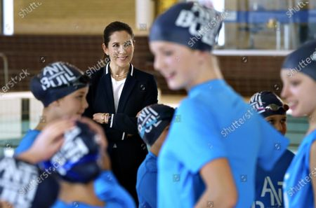 Danish Crown Princess Mary (C) focuses on Antibulli Swimming during a visit to Helsingoer Swimming Club, in Helsingoer , Denmark, 22 October 2020. Helsingoer Swimming Club is one of the swimming clubs that use the Antibulli Swimming initiative, which has been developed in a collaboration between Mary Foundation and the Danish Swimming Union. The purpose of Antibulli Swimming is to promote the feeling of togetherness and combat bullying in children's swimming.