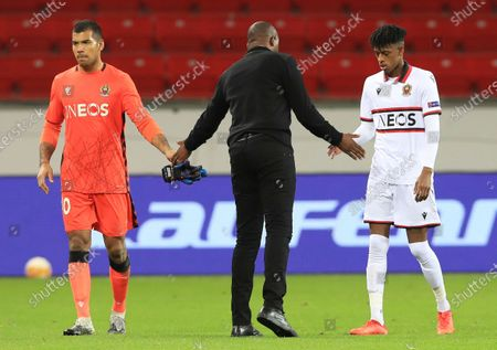 Nice coach Patrick Vieira comforts his players after the Europa League group C soccer match between Bayer Leverkusen and OGC Nice in Leverkusen, Germany