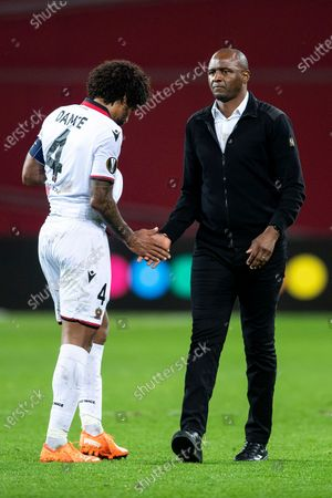 Nice's Dante and coach Patrick Vieira react after losing the Europa League group C soccer match between Bayer Leverkusen and OGC Nice in Leverkusen, Germany