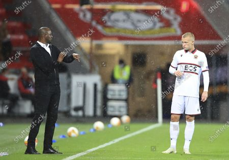 Nice coach Patrick Vieira talks to Kasper Dolberg during the Europa League group C soccer match between Bayer Leverkusen and OGC Nice in Leverkusen, Germany