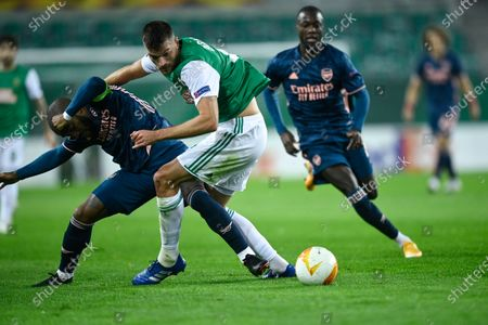 Alexandre Lacazette (L) of Arsenal and Mateo Barac (C) of Rapid Vienna in action during the UEFA Europa League group B soccer match between SK Rapid Vienna and Arsenal FC in Vienna, Austria, 22 October 2020.