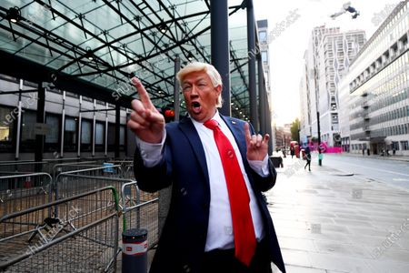 A Donald Trump impersonator outside the Department for Business, Energy and Industry, 1 Victoria Street, where ongoing Brexit negotiations are taking place.