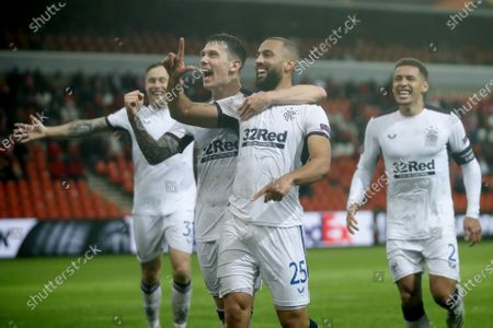 Rangers' Kemar Roofe, center, jubilates with teammates after scoring his sides second goal during a Europa League Group D soccer match between Standard Liege and Rangers at the Maurice Dufrasne stadium in Liege, Belgium
