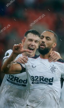Rangers' Kemar Roofe, right, jubilates after scoring his sides second goal during a Europa League Group D soccer match between Standard Liege and Rangers at the Maurice Dufrasne stadium in Liege, Belgium