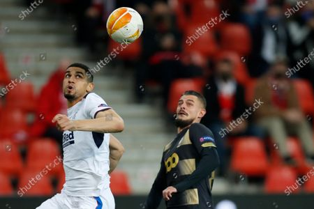 Rangers' Leon Balogun, left, eyes the ball against Liege's Maxime Lestienne during a Europa League Group D soccer match between Standard Liege and Rangers at the Maurice Dufrasne stadium in Liege, Belgium