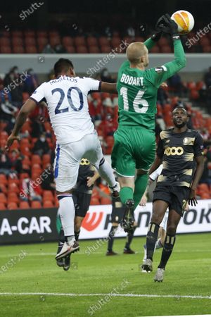 Liege's goalkeeper Arnaud Bodart, center, goes up to block the ball while challenged by Rangers' Alfredo Morelos, left, during a Europa League Group D soccer match between Standard Liege and Rangers at the Maurice Dufrasne stadium in Liege, Belgium